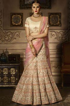 Beige Color Silk Heavy Embroidery Work Traditional Party Wear Lehenga Choli #zikkra #royalseries #partycollection #weddinhlehenga #lehengacholi #embroidered #pinklehenga #silkfabric #indianlook #indianweddingseason #bridalwear #outfit #floorlength #gownstyle #zariwork #womenfashion #newarraival #latestdesign