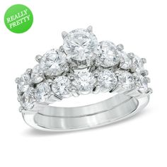 Zales: 3 CT. T.W. Diamond Three Stone Three Piece Bridal Set in 14K White Gold, very similar to my set now but larger side stones