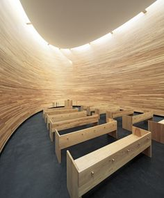 Completed in 2012 in Helsinki, Finland. Images by Tuomas Uusheimo . The Kamppi Chapel is located on the south side of the busy Narinkka square in central Helsinki. It offers a place to quiet down and compose oneself. Sacred Architecture, Church Architecture, Religious Architecture, Interior Architecture, Helsinki Design, Curved Wood, Curved Walls, Modern Church, Wood Panel Walls