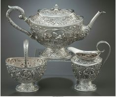 A THREE-PIECE DUTCH SILVER TEA SERVICE Holland, circa 1925-1926 Marks: (lion passant with 2), (z-hammer-z), P 6-1/8 inches high (15.6 cm) (tea pot) 34.9 ounces (gross).
