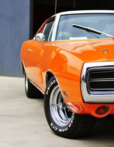 orange muscle car.  WOOF    #MuscleCars #LoveOnlineToday.com