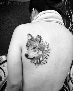Wolf tattoo on back shoulder by Ariel Nirakara
