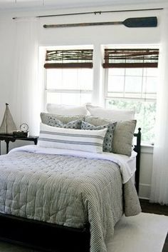 Lettered Cottage – Guest Bedroom Reveal | The Lettered Cottage- oar hanging above the bed is from world market $19