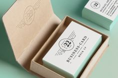 This is the light themed psd business card mock-up template with its elegant cardboard box. (3,15x2 inch)...