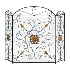 Transform your fireplace into a showcase of elegant style with this luxurious fireplace screen. Made from black iron mesh and embellished with golden ornaments,