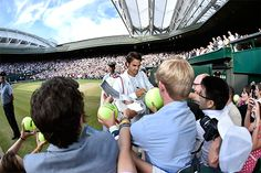 Roger Federer signs autographs after his Semi-final victory