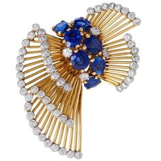 Cartier Paris Mid-20th Century Sapphire Diamond Gold Platimum Bow Brooch   From a unique collection of vintage brooches at https://www.1stdibs.com/jewelry/brooches/brooches/