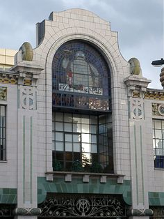 "Michelin House London. This is a former Michelin garage built before WWI in a transition style from Art Nouveau to Art Deco. The architect was a former French employee of the tyre company Michelin.  The building has been successfully converted to the use of a fish gourmet restaurant / bar ""Bibendum"", a small flower and fish market and a Conran shop."