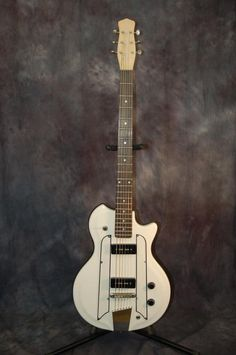 Today, Lawman Guitars is Presenting...A really cool Baritone Guitar in great shape with new Strings and a Pro Setup...This is a Resoglass Body with a Danelectro Baritone Neck and it is awesome! Comes with the shown BRAND NEW Profiles Bass Gigbag! Give us a call. Lawman Guitars. 515-864-6136