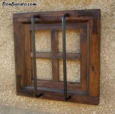 Ventana rustica madera con rejas forjada