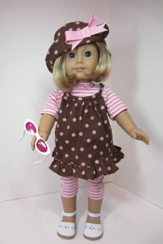 Kit is into poke-a-dots. She has a hat full of dots and a top to match. The stripped tee and leggings repeat the pink of the dots and hat bow. White sandals and pink sunglasses complete her look. SC-4