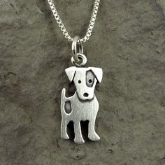 This adorable little Jack Russell is made of brushed sterling silver. The pendant measures about 5/8 tall, which means hes a TINY Jack Russell, but thats a big part of what makes him so cute. You can purchase just the pendant/charm, or complete the necklace with a sterling silver box