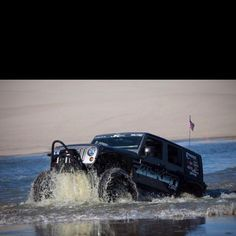 Up from the depth 6' tall Godzilla . No it's just a Jeep. An awesome one at that.