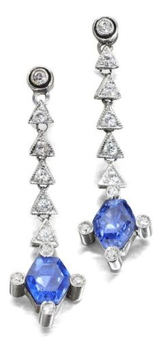 A pair of Art Deco sapphire and diamond earrings, early 20th century. Each formed as a single-cut diamond suspending a series of five articulated triangular links, each set with a round brilliant-cut diamond further suspending a hexagonal-cut sapphire to a four claw setting, the claws each with an old round brilliant-cut diamond detail, to later screw fittings, length 34mm. #ArtDeco #earrings