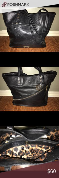Jessica Simpson Handbag Black with gold accents. Excellent condition . Normal wear to the straps . Bags Shoulder Bags