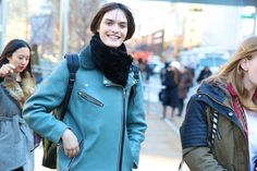 Sam Rollinson. Teal leather biker jacket with fur