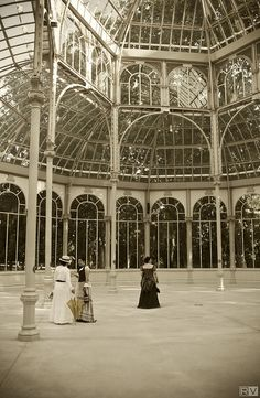 Victorian ladies inside the Crystal Palace. The Crystal Palace is a metal and glass structure located in the Jardines del Retiro in Madrid (Spain). It was built in 1887 for the Exposition of the Philippines, held that year. It was inspired by the Crystal Palace, Paxton (U.K.).