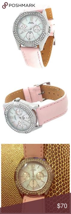 Guess Water Resistant Watch w/ Swarovski Crystals Polished silver-tone case with crystals and genuine mother-of-pearl multi-function dial (day, date, and international time). Pink smooth genuine leather strap with buckle clasp. Crystallized with Swarovski crystals. Water resistant for 100 meters/330 feet. Great condition, just minor signs of wear on band but mainly on part that goes on the back (pictured). No scratches to face of watch. Needs new battery. No box but ships in jewelry pouch…
