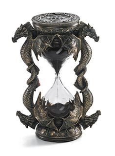 "Dragon Hourglass Pairs of patient dragons frame this hourglass, as the black sands count the minutes - what happens next, the dragons will not say. 6"" tall bronzed resin hourglass marks five minutes of time."