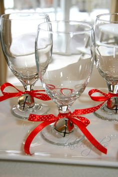 embellished glassware with ribbon and bells