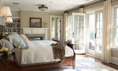 We can just imagine the sunset coming through these doors across from the bed. And who doesn't love a bedroom with a fireplace? The architectural details of a room can set a beautiful comfort zone for rest, relaxation, secrets, and dreams.