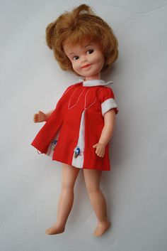 These Penny Bright dresses are cute tops for a Blythe doll...plenty out there in good condition...sort of a velvet composition to the fabric...so make sure you buy one that's not crumpled or dirty as I wouldn't know how to clean it...Penny Bright, made 1963-70.  Made by Deluxe Reading.