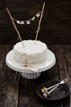 Ingredients: Cake 1+1/3 cup of whole wheat pastry flour 1/2 tsp baking powder 1/8 tsp salt 1 cup thick full fat coconut cream 1/3 cup sugar 2 eggs 2 tbsp coconut rum Meringue frosting 1 large egg w...