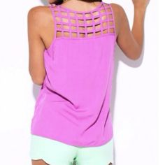 Purple Cut Out Shirt New never used. I only have 3 left, two small and one large. Lowest I will take is $30. If interested please let me know so that I can adjust the price and you can take advantage of $1.99 shipping. Tops