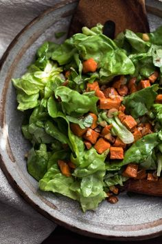 This beautiful fall salad features sweet potatoes roasted with garlic and olive oil then tossed in a salad with butter lettuce and a delicious dressing. The hazelnut dressing is made with unsalted butter, hazelnuts, lemon, and maple syrup- a real cool-weather treat!