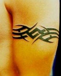 Photo of an armband tribal tattoo.