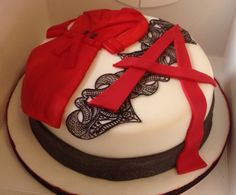 Perfect fan cake Pretty Little Liars inspired cake. Edible lace and embossed ribbon. Mystery A and the fab red coat complete the look.