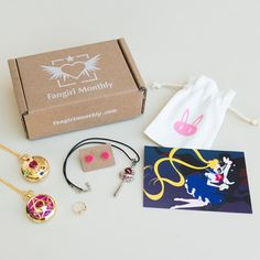 Anime & manga inspired jewelry and accessory subscription box. Each month you will receive pieces of jewelry and goodies including a collectible postcard and custom jewelry bag. Kawaii Subscription Box, Book Subscription Box, Monthly Subscription, Phone Wallpaper Pink, Man Wallpaper, Girl Shadow, Pastel Photography, Monthly Themes, Aesthetic Colors