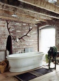 Antlers Bathtub Rustic bathroom Outside inside Rafters Large window