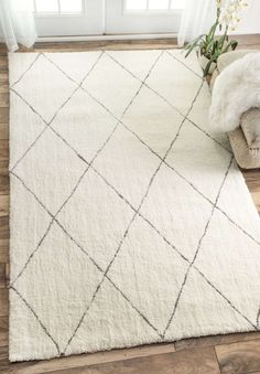 A hand-made plush area rug providing texture and style.