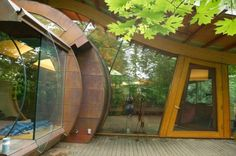 Unusual Forest Home From Natural Materials. It looks as though the windows are concave, very cool!