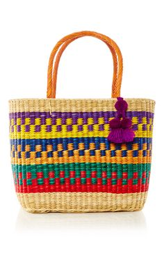 Nannacay bags are made from fibers extracted from the Peruvian Coast, each bag is unique and dyed by hand. All pom-poms are made in the Andes at an altitude of 3,700 meters. This **Nannacay** Madagascar Maha Tote is hand-crafted by Peruvian artisans in multi-colored raffia straws and features a playful pom-poms and tassels detailing.