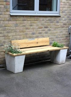 Bench from salvaged scaffolding boards and planters from cast concrete with re-claimed aggregates