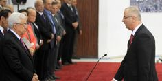 RAMALLAH, West Bank (AP) — President Mahmoud Abbas swore in a Palestinian unity government Monday, taking a major step toward ending a crippling split with his Hamas rivals, but also setting the stage for new friction with Israel and possibly w...