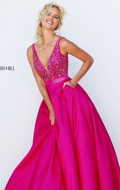 Let all eyes be on you in Sherri Hill 50233. Revealing V-neckline with sheer inset at center front is complimented with a flattering V-back. The top is accented with dazzling beads that is sure to make you the center of attention at any event. The full-length ball skirt provide structure.