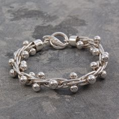 Silver ball bracelet. This simple, heavy and detailed bracelet is an attractive addition to any outfit! #Jewellery #bracelet #round #accessories