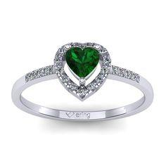 Inelul este realizat din aur alb 14k, greutate: ~2.00gr. Produsul are in componenta sa: 1 x smarald, dimensiune: ~4.00x4.00mm, culoare: VERDE, forma: heart 12 x diamant, dimensiune: ~1.00mm, greutate totala: ~0.06ct, culoare: G, claritate: SI1, forma: round 8 x diamant, dimensiune: ~1.10mm, greutate totala: ~0.05ct, culoare: G, claritate: SI1, forma: round