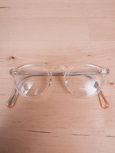 Oliver Peoples (my all time favorite brand of glasses)  Great shape, transparent frame