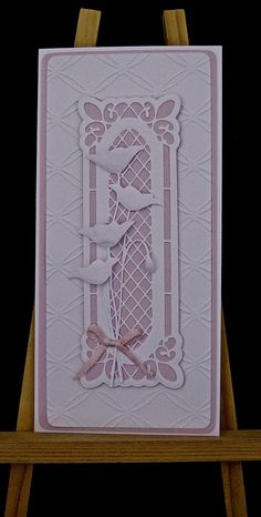 DL card. Creative Expressions bright white and lilac foundation card. Sue Wilson design triplets - Lattice window. Tattered Lace, chains embossing folder (EF003). Memory box prim poppy die.