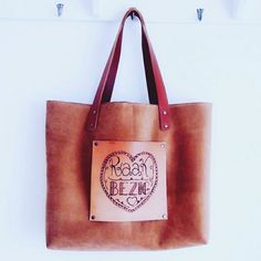 Leather bag handmade, not by me. The bag is made by Atelier Sandmate. The logo is printed/burned in the leather by me.