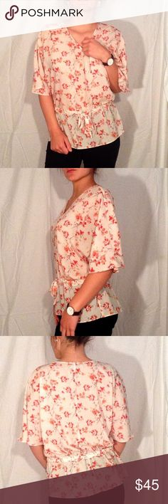 """Ann Taylor pink floral print top, half sleeve 🔹Fit: fits like a loose medium. Cinches at the waist. Loose half sleeves for comfort and style 🔹Material : 100% polyester 🔹Material Characteristics: soft and comfortable. Perfect flowy shirt for those warm summer nights 🔹 like new 🔹 Model measurements: Bust: 36 in. Waist: 31 in. Hips: 35.5 in. Height: 5'7"""". Weight: 140 🔹 Ann Taylor Tops Blouses"""