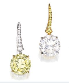 Fancy intense yellow, and white diamond earrings.