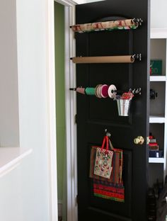 Use Ordinary Curtain Rods To Create A Behind-the-door Wrapping Paper Station