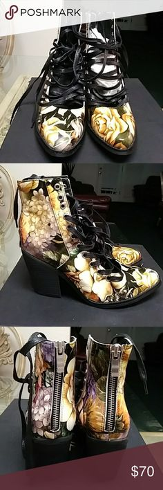 Floral ankle lace up booties 100% leather upper,  lace up floral ankle booties made by YES ! The lace up booties are yellow, black, cream, hint of purple and grass green. Worn once. Size 41 European US 10. ALL OFFERS ARE CONSIDERED ! YES Shoes Lace Up Boots