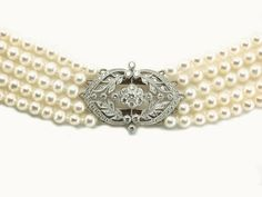 Floral diamond clasp with five rows of freshwater pearls  http://www.luciecampbell.com/necklaces/All/1208--7/  £3950    richard@luciecampbell.com  Lucie Campbell Jewellers Bond Street London  http://www.luciecampbell.com