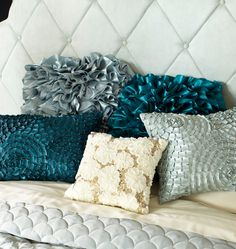 Ruffles, sequins, rosettes–they all create chic statement pillows
